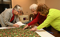 NWA Democrat-Gazette/ANDY SHUPE<br /> Ardith Wharry (from left), Marie Breuer, Cornelia &quot;Neely&quot; Barnett and Libby Dutton work together Wednesday, March 15, 2017, to make sleeping bags for area homeless in the chapel at Butterfield Trail Village in Fayetteville. The group has made approximately 30 bags over the past few years using the &quot;My Brother's Keeper&quot; quilt group model, a national volunteer effort that promotes &quot;The Sleeping Bag Project.&quot;