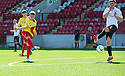 Albion's Chris Cadden scores their first goal.