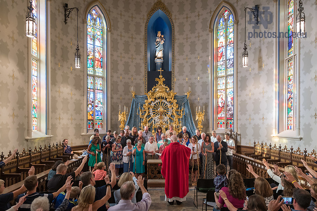 August 25, 2017; ND Trail day 12: Core pilgrims receive commemorative walking sticks and a blessing following Mass in the Basilica of the Sacred Heart. (Photo by Matt Cashore/University of Notre Dame)
