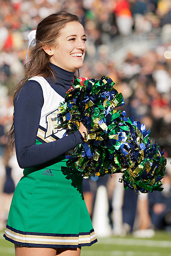 Notre Dame cheerleader Mary Katheryn Snyder performs during NCAA football game between Notre Dame and Navy.  The Notre Dame Fighting Irish defeated the Navy Midshipmen 56-14 in game at Notre Dame Stadium in South Bend, Indiana.