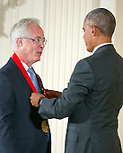 United States President Barack Obama presents the 2015 National Humanities Medal to Louis Menand, Author of Cambridge, Massachusetts, during a ceremony in the East Room of the White House in Washington, DC on Thursday, September 22, 2016.<br /> Credit: Ron Sachs / CNP