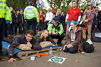 Police caution Extinction Rebellion protesters in London on 09 October 2019 in London, England.<br /> .<br /> Protesters plan to blockade the London government district for a two week period, as part of 'International Rebellion' taking place in over 60 cities around the world, calling for decisive and immediate action from governments in the face of climate and ecological emergency. <br /> .<br />  Photo by Alan  Stanford.