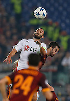 Leverkusen's Hakan Calhanoglu fight for the ball  during the Champions League Group E soccer match between As Roma and  Bayer Leverkusen at the Olympic Stadium in Rome, November 04 2015