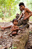 PHILIPPINES, Palawan, Barangay region, young Batak boy named Noy Noy plays with a machete at their home in Kalakwasan Village