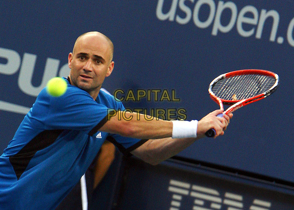 ANDRE AGASSI .Atmosphere before 2005 US Open Tennis Men's Championship starts, Flushing, NY. .September 11th, 2005.Photo Credit Jackson Lee/Admedia.half length sport blue shirt racket .www.capitalpictures.com.sales@capitalpictures.com.© Capital Pictures.