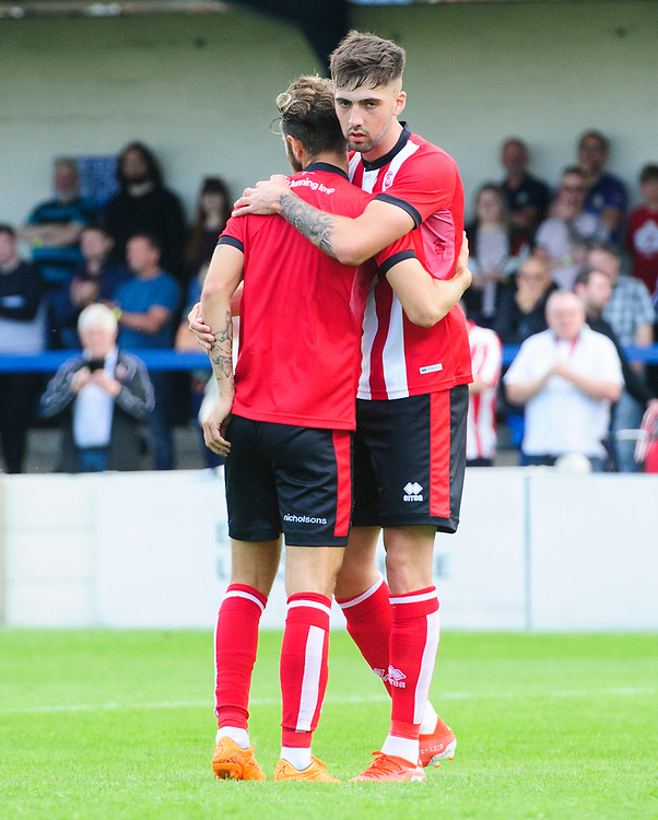 Lincoln City's Jorge Grant, left, celebrates scoring his side's third goal, from the penalty spot, with team-mate Ellis Chapman <br /> <br /> Photographer Chris Vaughan/CameraSport<br /> <br /> Football Pre-Season Friendly (Community Festival of Lincolnshire) - Gainsborough Trinity v Lincoln City - Saturday 6th July 2019 - The Martin & Co Arena - Gainsborough<br /> <br /> World Copyright © 2018 CameraSport. All rights reserved. 43 Linden Ave. Countesthorpe. Leicester. England. LE8 5PG - Tel: +44 (0) 116 277 4147 - admin@camerasport.com - www.camerasport.com