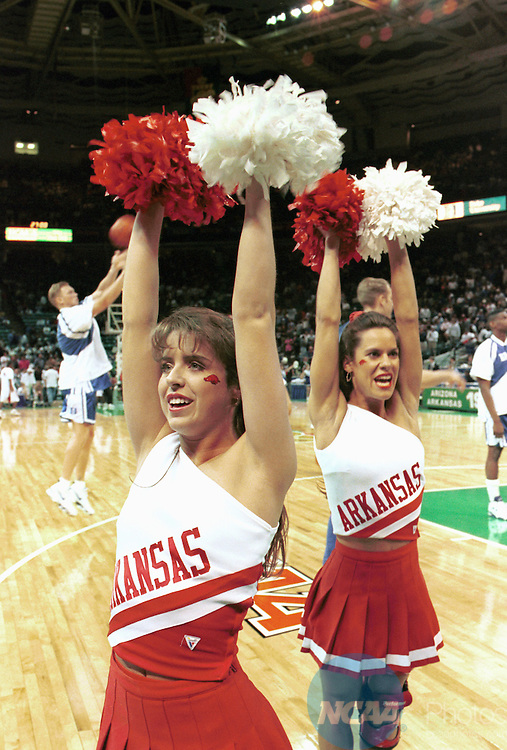 4 APR 1994: University of Arkansas cheerleaders get the Arkansas fans warmed up as the Duke University basketball team prepares for the NCAA National Basketball Championship game at the Charlotte Coliseum in Charlotte, NC. Arkansas defeated Duke 76-72 to win the championship title. Rich Clarkson/NCAA Photos.