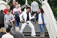 "NO REPRO FEE. 11/8/2010. Elvis Presley Story. Irelands foremost Elvis performer Kevin Doyle is pictured in his Elvis costume rehearsing on the Ha Penny Bridge Dublin with Mimi in preparation for his show "" Kevin Doyle Sings the Elvis Presley Story"" this Sunday the 15th of August at the Olympia Theatre. Tickets are from 25.50 including booking fee on sale now. Picture James Horan/Collins Photosemail - info@collinsphotos.com"