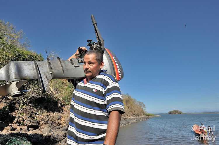 Danilo Osorio brings his motor ashore after fishing off the coast of Honduras in the Gulf of Fonseca. Along with other families in the village, he has lost access to some land and parts of the ocean in recent years as the wealthiest family in Honduras has moved in, fencing off vast areas.