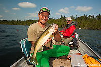 Male angler with walleye