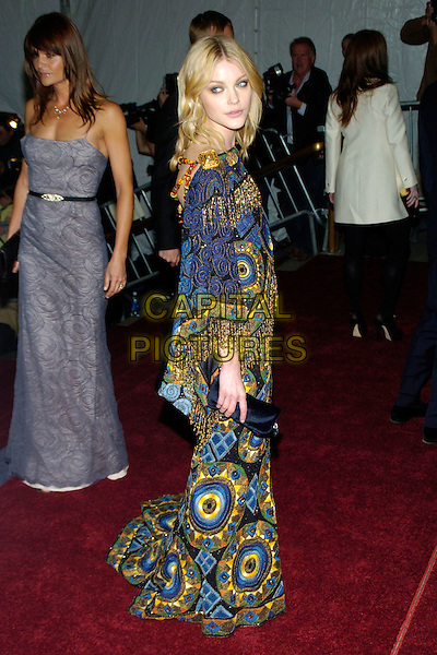 "JESSICA STAM .2007 Metropolitan Museum of Art Costume Institute Gala celebrating ""Poiret: King of Fashion"" exibition at the Metropolitan Museum of Art, New York City, New York, USA..May 7th, 2007.full length black clutch purse blue purple yellow tassels print pattern dress.CAP/ADM/BL.©Bill Lyons/AdMedia/Capital Pictures *** Local Caption ***"