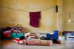 A former drug user takes a nap at Orkas Khnom, or My Chance, a government-run facility where youth and young men are brought here by their families or by arrest from police to be re-educated from drug addiction, just outside Phnom Penh, Cambodia, on Tuesday, May 11, 2010.