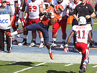 Virginia wide receiver Keeon Johnson (85) makes a catch in front of Ball State defensive end Jonathan Newsome (11) during the football game Saturday Oct. 5, 2013 at Scott Stadium in Charlottesville, VA. Ball State defeated Virginia 48-27. Photo/The Daily Progress/Andrew Shurtleff