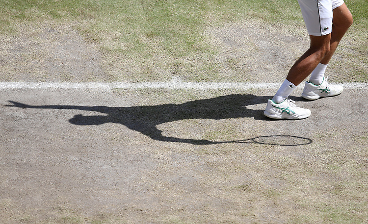 A close-up of the shadow Novak Djokovic (SRB) during his match against Roberto Bautista Agut (ESP) in their Gentleman's Singles Semi-Final match<br /> <br /> Photographer Rob Newell/CameraSport<br /> <br /> Wimbledon Lawn Tennis Championships - Day 11 - Friday 12th July 2019 -  All England Lawn Tennis and Croquet Club - Wimbledon - London - England<br /> <br /> World Copyright © 2019 CameraSport. All rights reserved. 43 Linden Ave. Countesthorpe. Leicester. England. LE8 5PG - Tel: +44 (0) 116 277 4147 - admin@camerasport.com - www.camerasport.com