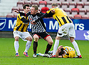 Pars' Andrew Geggan is held back by East Fife's Liam Buchanan (19) and Stephen Hughes (11) after he reacts to Lewis Barr's late challenge from behind.