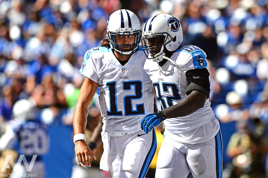 Sep 28, 2014; Indianapolis, IN, USA; Tennessee Titans quarterback Charlie Whitehurst (12) congratulates tight end Delanie Walker (82) after catching a pass for a touchdown during the second quarter against the Indianapolis Colts at Lucas Oil Stadium. Mandatory Credit: Andrew Weber-USA TODAY Sports