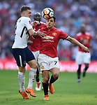 Alexis Sanchez of Manchester United is challenged by Kieran Trippier of Tottenham Hotspur during the FA cup semi-final match at Wembley Stadium, London. Picture date 21st April, 2018. Picture credit should read: Robin Parker/Sportimage