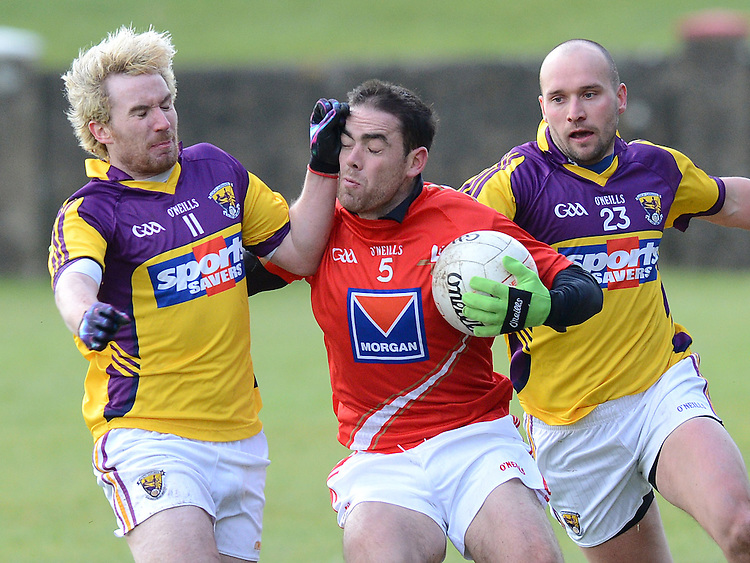 Louth John O'Brien Wexford Ben Brosnan and James Holmes. Photo:Colin Bell/pressphotos.ie