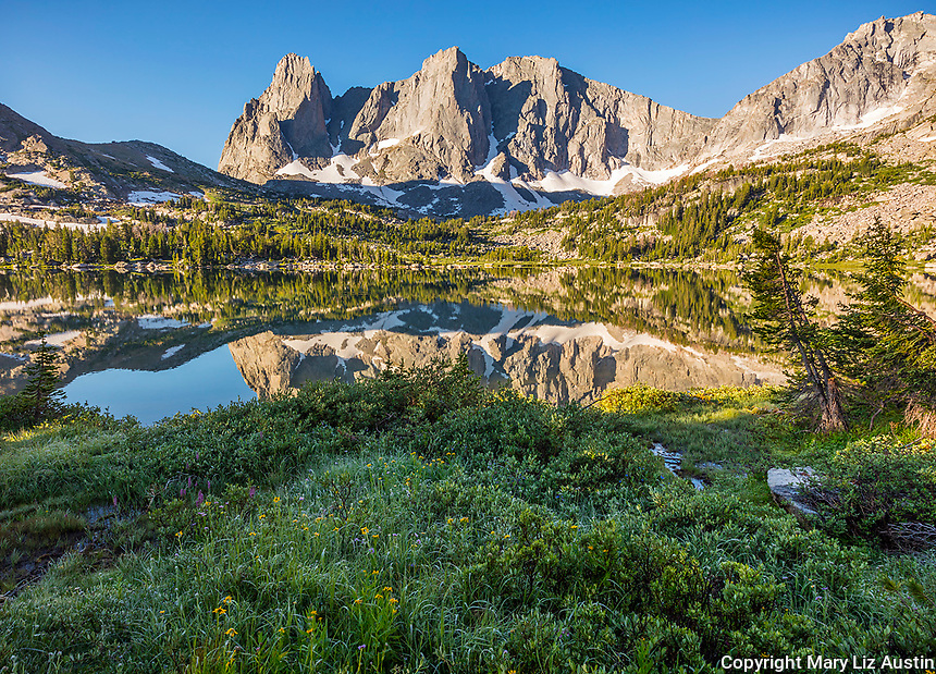 Wind River Range, WY: Morning light on Warrior Peaks and War Bonnet from the summer shoreline of Lonesome Lake in the Cirque of the Towers; Bridger Wilderness in the Bridger National Forest