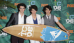 Kevin, Nick and Joe Jonas of the Jonas Brothers at the Teen Choice Awards 2008 pressroom at the Gibson amphitheatre at Universal City Walk, Ca. August 3, 2008. Fitzroy Barrett