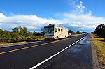 A motor home, recreational vehicle, travels a highway in New Mexico after a strom.