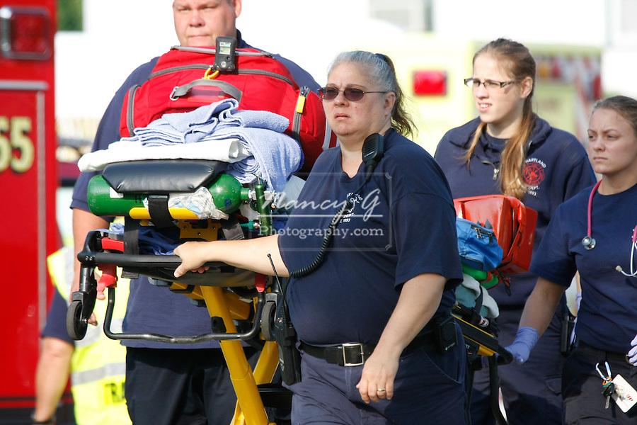 An EMT team walking from an Ambulance