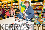 front of the queue Nuala Costello and Dan Kiely  to get their books signed by Paul Galvin in Eason's Tralee on Saturday