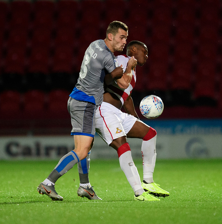 Lincoln City's Harry Toffolo vies for possession with Doncaster Rovers' Niall Ennis<br /> <br /> Photographer Chris Vaughan/CameraSport<br /> <br /> EFL Leasing.com Trophy - Northern Section - Group H - Doncaster Rovers v Lincoln City - Tuesday 3rd September 2019 - Keepmoat Stadium - Doncaster<br />  <br /> World Copyright © 2018 CameraSport. All rights reserved. 43 Linden Ave. Countesthorpe. Leicester. England. LE8 5PG - Tel: +44 (0) 116 277 4147 - admin@camerasport.com - www.camerasport.com