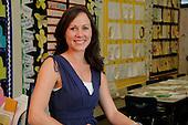 Stock photo of female school teacher in classroom