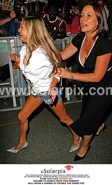 ALL ROUND PICTURES BY SOLARPIX.COM.MUST CREDIT SOLARPIX.COM OR DOUBLE FEE CHARGED.Nikki Grahame is evicted from the Big Brother House..14/07/06. Elstree, Hertfordshire..This Pic shows:Presenter Davia Mccall evicting Niki Grahame from the house.JOB REF:PRS 2584 14.7.06..