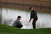February 3rd 2019, Scottsdale, Arizona, USA;  Jason Kokrak and Trey Mullinax discuss the lie of Mullinax's shot on the 18th hole. A PGA official was called in to resolve the situation at the final round of the Waste Management Phoenix Open on February 3, 2019, at TPC Scottsdale in Scottsdale, Arizona.