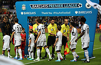Pictured: Team players greeting each other.<br /> Monday 16 September 2013<br /> Re: Barclay's Premier League, Swansea City FC v Liverpool at the Liberty Stadium, south Wales.