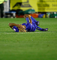 AFC Wimbledon's Lyle Taylor is down injured during the Carabao Cup match between AFC Wimbledon and Brentford at the Cherry Red Records Stadium, Kingston, England on 8 August 2017. Photo by Carlton Myrie.