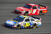 Oct. 11, 2009; Fontana, CA, USA; NASCAR Sprint Cup Series driver Greg Biffle (16) races alongside Kasey Kahne during the Pepsi 500 at Auto Club Speedway. Mandatory Credit: Mark J. Rebilas-
