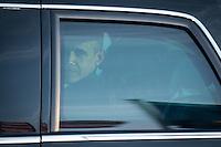 Berlin, der US-amerikanische Praesident Barack Obama sitzt am Dienstag (18.06.13) am Flughafen Tegel in Berlin, im Auto. Foto: Maja Hitij/CommonLens
