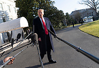 January 6, 2019 - Washington, DC, United States: United States President Donald J. Trump speaks to the media as he departs the White House headed to Camp David.<br /> (Chris Kleponis / Polaris)United States President Donald J. Trump speaks to the media as he departs the White House in Washington, DC for Camp David on Sunday, January 6, 2019.<br /> CAP/MPI/RS<br /> &copy;RS/MPI/Capital Pictures