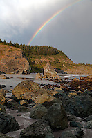 Rainbow over the Southern Oregon shoreline at Rainbow Rock north of Brookings, Oregon.