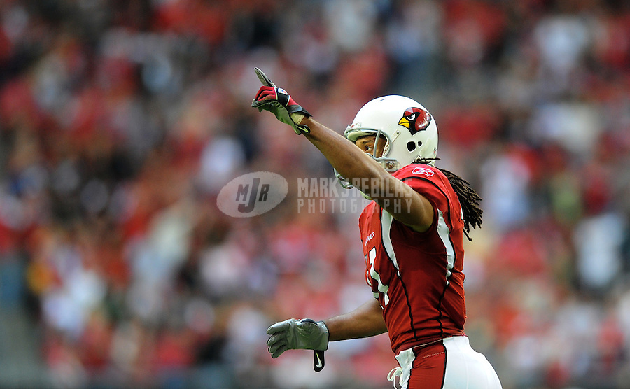 Dec. 7, 2008; Glendale, AZ, USA; Arizona Cardinals wide receiver Larry Fitzgerald celebrates after scoring a first quarter touchdown against the St. Louis Rams at University of Phoenix Stadium. Mandatory Credit: Mark J. Rebilas-