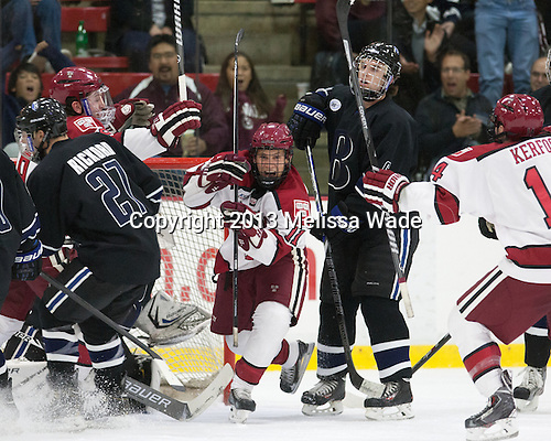 Kyle Criscuolo (Harvard - 11) - The Harvard University Crimson defeated the visiting Bentley University Falcons 3-0 on Saturday, October 26, 2013, in Harvard's season opener at Bright-Landry Hockey Center in Cambridge, Massachusetts.
