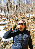 Founder, COO and ETC of Spring 44 Jeff McPhie at the source spring for the water used by the distillery in the mountains outside of Loveland, Colorado, Tuesday, February 15, 2017. Spring44, which makes craft vodka and gin, uses only pure water collected from a spring located in Colorado's Buckhorn Canyon. The property is extremely remote, accessible only by navigating an 11-mile dirt road, culminating with a 2.5-mile jeep trail climbing 2,000 feet of elevation. <br /> <br /> Photo by Matt Nager