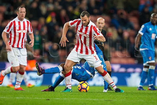 19.11.2016. Bet365 Stadium, Stoke, England. Premier League Football. Stoke City versus AFC Bournemouth. Stoke City defender Erik Pieters aviods being tackled by Bournemouth forward Benik Afobe.