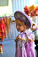 10 year old child dressed in clothing as worn by the long-departed Vietnamese royal family. Da Lat, Vietnam
