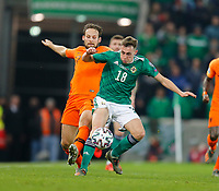 16th November 2019; Windsor Park, Belfast, Antrim County, Northern Ireland; European Championships 2020 Qualifier, Northern Ireland versus Netherlands; Daley Blind of Netherlands tries to tackle the ball away from Myron Boadu of Netherlands - Editorial Use