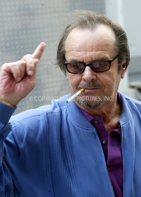 WWW.ACEPIXS.COM . . . . .  ....NEW YORK, APRIL 20, 2005....Jack Nicholson on a photo set downtown lights up a Camel and signs a few autographs.....Please byline: Ian Wingfield - ACE PICTURES..... *** ***..Ace Pictures, Inc:..Craig Ashby (212) 243-8787..e-mail: picturedesk@acepixs.com..web: http://www.acepixs.com