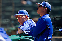 (L-R) Kentucky Wildcats head coach Gary Henderson #20 and assistant coach Brian Green watch the action against the Utah Utes at Minute Maid Park on March 6, 2011 in Houston, Texas.  Photo by Brian Westerholt / Four Seam Images