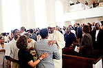 Reverend Dr. Gerald L Durley preaches health to his congregation. His congregation honored him during the service August 15, 2010 in celebration of Rev. Dr. Durley's 23rd pastoral anniversary at Providence Missionary Baptist Church. He greets members of the congregation during the service in Atlanta, Georgia August 15, 2010.