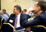 SOUTHBURY, CT-012318JS03--Nelson Merchan with the Small Business Development Center, listens to local legislators during the Waterbury Regional Chamber's Legislative and Economic Summit held Tuesday at the Wyndham Southbury. <br /> Jim Shannon Republican-American