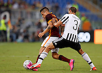 Calcio, Serie A: Roma vs Juventus. Roma, stadio Olimpico, 30 agosto 2015.<br /> Roma&rsquo;s Juan Iturbe, left, is challenged by Juventus&rsquo; Giorgio Chiellini during the Italian Serie A football match between Roma and Juventus at Rome's Olympic stadium, 30 August 2015.<br /> UPDATE IMAGES PRESS/Riccardo De Luca