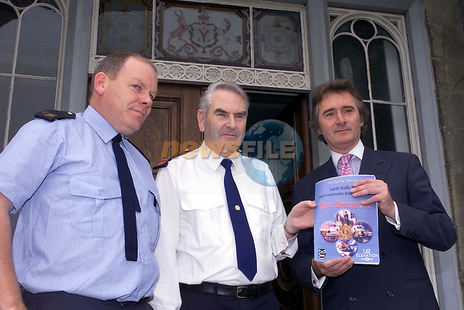 Stg. Eamon Tobin from Slane garda Station with Supt. Eamon Courtney from Navan and Lord Henry Mountcharles holding the Garda Traffic Plan at the Press conference in Slane castle...Picture Fran Caffrey Newsfile.
