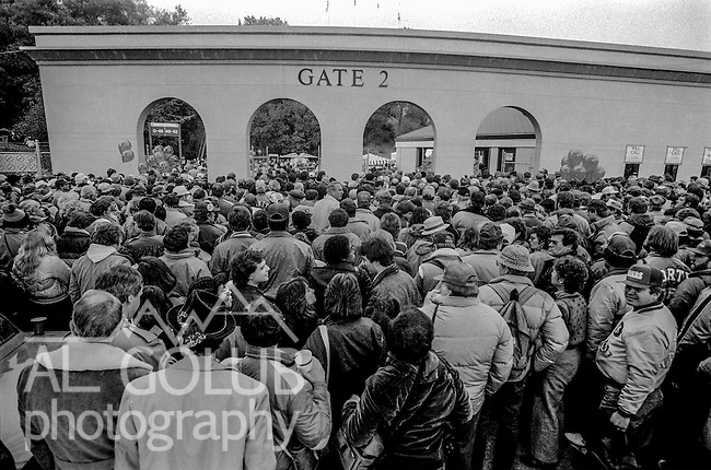 Crowd files through gate 2 on the way into the stadium after leaving the Super Bowl XIX tailgate on the Stanford University campus. The San Francisco 49ers defeated the Miami Dolphins 38-16 on Sunday, January 20, 1985.